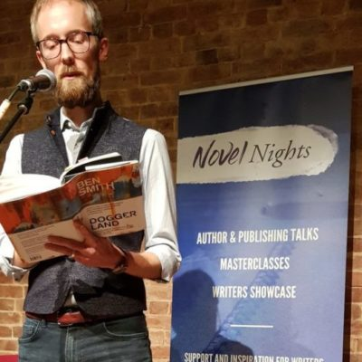 Image of Ben Smith with Novel Nights banner in the background