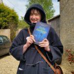 Author Mel Golding holding her novel Little Darlings